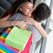 Loving couple at a shopping mall — Stock Photo