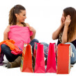 Stock Photo: Girls looking at their purchases