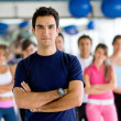 Gym man with group — Stock Photo