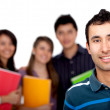 Man with a group of students — Stock Photo