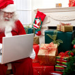 Santa Claus with a laptop — Stock Photo #7746725