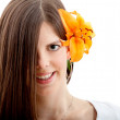 Beautiful woman with a flower — Stok fotoğraf