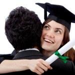Graduation woman hugging a man — Stock Photo
