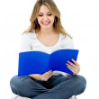 Female student reading — Stock Photo