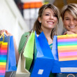 Girls with paper bags — Stock Photo