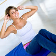 Woman exercising her abs — Stock Photo