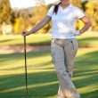 Woman playing golf - Stock fotografie