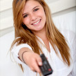 Girl with a remote control — Stock Photo