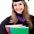 Graduated woman with books — Stock Photo