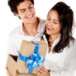 Man giving his girlfriend a present - Stock Photo