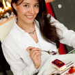 Woman at a restaurant - Stock Photo