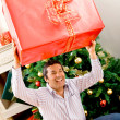 Man with a Christmas present — Stock Photo