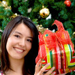 Woman with Christmas gift — Stock Photo #7747558