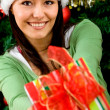 Woman with Christmas gift — Stock Photo #7747560