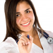 Stock Photo: Female doctor holding pen