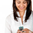 Woman texting on her cell — Stock Photo