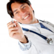 Male doctor holding a pen — Stock Photo
