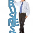 Man leaning on word business — Stock Photo