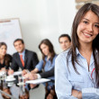 Business woman leading a team — Stock Photo #7747794