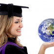 Graduation woman holding earth — Stock Photo
