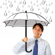 Stock Photo: Business man with umbrella