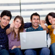 Happy group with laptop — Stock Photo #7747874