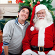 Stock Photo: Happy couple with Santa Claus
