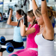Women at the gym exercising — Stock Photo