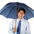 Business man with an umbrella - Stock Photo