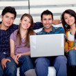 Casual group with laptop — Stock Photo