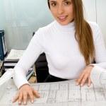 Female architect with blueprints — Stock Photo