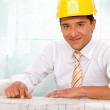 Foto Stock: Male architect with blueprints