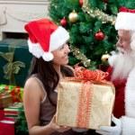 Santa Claus giving a present — Stock Photo
