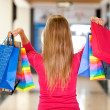 Woman holding shopping bags — Stock Photo #7748086
