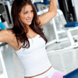 Woman at the gym exercising — Stock Photo #7748094
