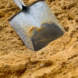 Shovel with sand - Stock Photo
