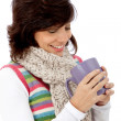Winter woman with hot drink — Stock Photo