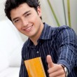 Student with thumbs-up — Stock Photo #7748290