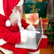 Santa with a laptop — Stock Photo