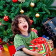 Little boy with a Christmas present - Stock Photo
