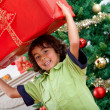 Boy with a Christmas present — Foto Stock