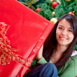 Woman with Christmas gift — Stock Photo #7748309