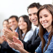 Stock Photo: Business team clapping
