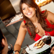 Woman at a restaurant — Stock Photo