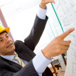 Stock Photo: Engineer looking at blueprints