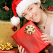 Christmas gifts by santa claus - Stock Photo