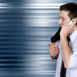 Stock Photo: Business on the move - cell phone