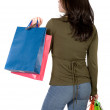 Girl with shopping bags from behind - Stock Photo