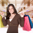 Girl in a shopping center - Stock Photo