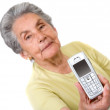 Grandmother with a mobile phone on her hand - Stock Photo